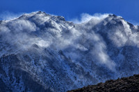 Winds whip up newly fallen snow on the high peaks above Onion Valley